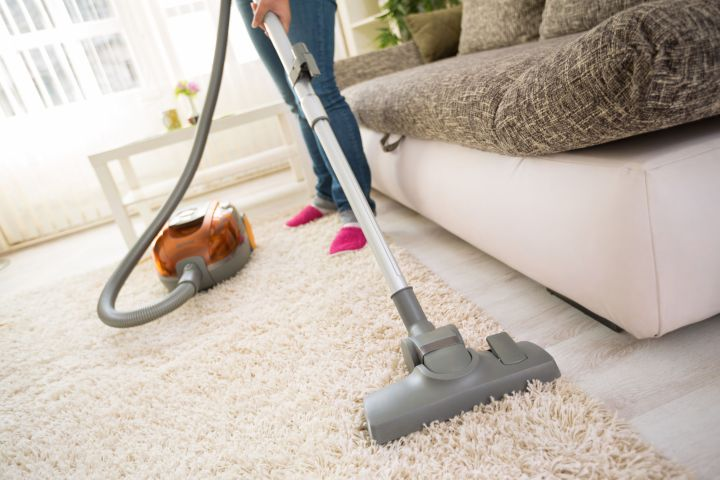 54016383 - cleaning carpet with vacuum cleaner in living room